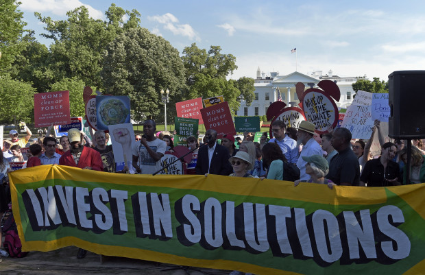 Activists gather outside the White House in Washington, Thursday, June 1, 2017, to protest President Donald Trump's decision to withdraw the Unites States from the Paris climate change accord.