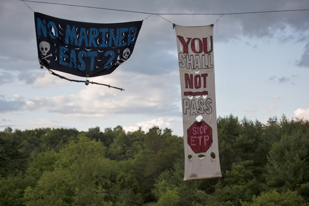 Protest signs at Camp White Pine near construction of the Mariner East 2 pipeline in Huntingdon County, Pennsylvania.