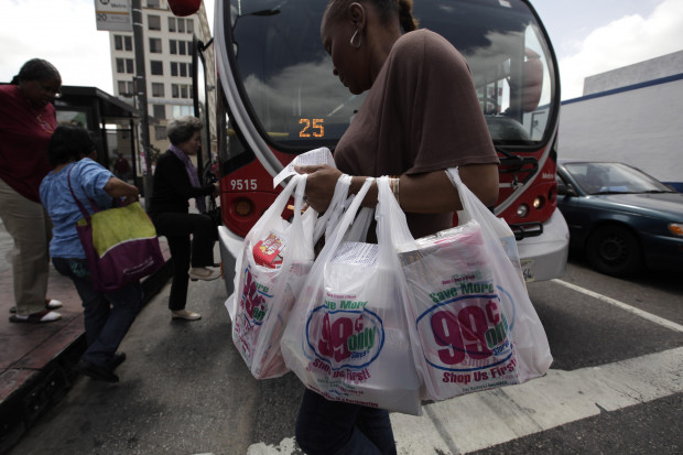 A woman carries her purchases in plastic bags in Los Angeles, Thursday, May 24, 2012. Gov. Wolf plans to veto a bill that would have forbid local plastic bag bans.