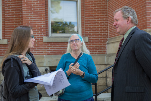 Ellen Gerhart (center) waits outside the Huntingdon County Courthouse with daughter Elise and attorney Rich Raiders.  A judge will decide whether or not to grant an injunction that could lead to the arrest of the Gerharts and their supporters.