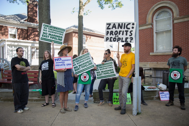 Lloyd Haun, Amber Colledge, Nancy Miller, Kaitlin Elliot, Nick Miller, and Andrew Geller demonstrate outside of the Huntingdon County Courthouse in support of the Gerhart family.