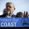 FILE - In this Jan. 31, 2016 file photo, Democratic U.S. Sen. Bob Menendez addresses a large rally in Asbury Park, N.J., opposing federal plans that would allow oil and gas drilling in the Atlantic Ocean. The Obama administration has moved to restrict access to offshore oil drilling leases in the Atlantic, as well as off Alaska. But President-elect Trump has said that he intends to open up offshore drilling, and environmentalists and coastal businesses say it could be the first major fault line that divides them from the new president.