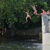 Teenagers take turns jumping into the Musconetcong river just below the Asbury Mill Dam. (Emma Lee/WHYY)