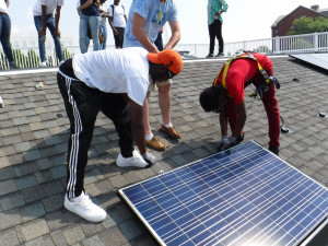 As part of the Solarize Philly program, the city is training Philadelphia public school students for future jobs on the solar industry. Danaje Elliott, on the right, was one of 18 students that completed the training this summer.