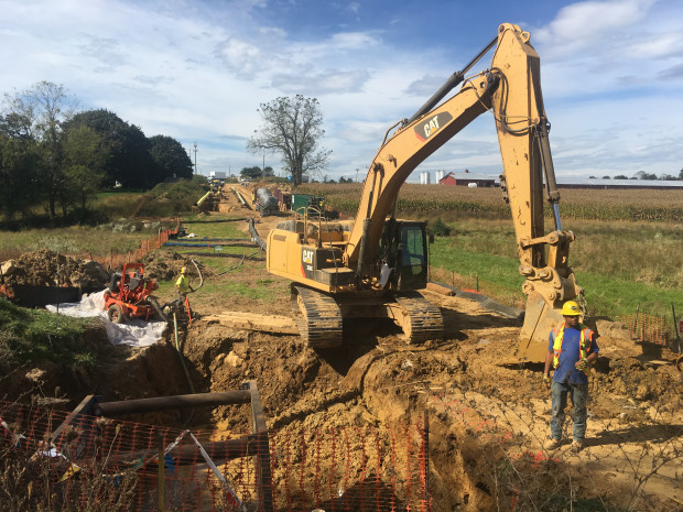 A backhoe works at a construction site for the Mariner East 2 pipeline in Lebanon County. Township officials say rock blasting at the site showered a nearby home with debris.