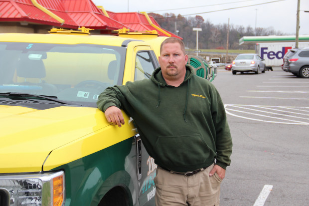 Elton Reha says he's happy he left coal mining to work at a lawn care company. Photo: Reid R. Frazier