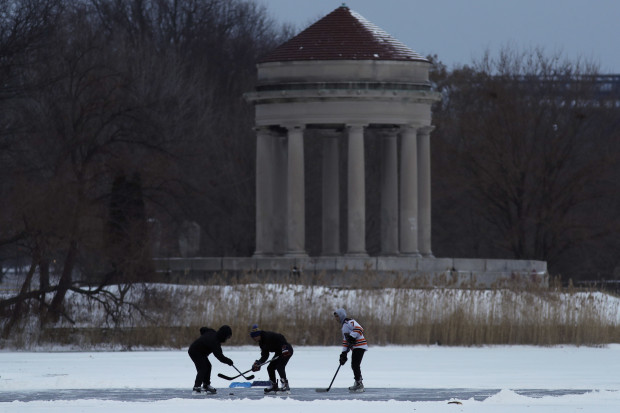 Youths play ice hockey on a frozen pond at Franklin Delano Roosevelt Park during a winter storm, Thursday, Jan. 4, 2018, in Philadelphia.