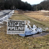A sign protesting the proposed PennEast Pipeline route in Carbon County, Pa. FERC issued an order which critics say effectively denies appeals against its approval of the project.