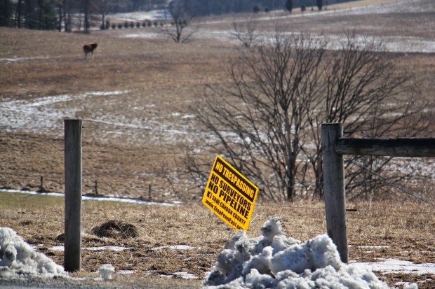 A sign on farmland near Palmerton in northeast Pennsylvania shows local opposition to the PennEast pipleline.Some believe land under the Farmland Preservation program has been targeted for the route because of it's lower market value. (Emma Lee/WHYY)