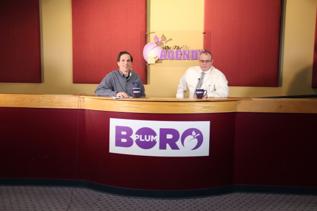 Plum borough manager Michael Thomas, right, being interviewed by Vince Lagrotteria for the community's local access television show. Photo: Reid R. Frazier