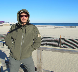 Paul Eidman stands along the boardwalk in Point Pleasant. Eidman owns a recreational fishing boat and makes his living off the tourist trade. He thinks fossil fuels should stay in the ground.