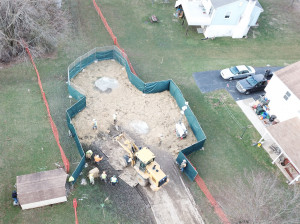 Crews work to stabilize sinkholes in a West Whiteland Township neighborhood on March 3. The sinkholes appeared recently near a construction site for the Mariner East 2 pipeline.