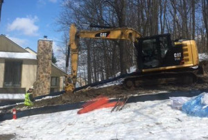 A backhoe excavates part of the Mariner East 1 Pipeline in Chester County's West Whiteland Township following this week's order by the Public Utility Commission that Sunoco must temporarily shut down the pipeline to make sure it's safe despite sinkholes that have developed in the area.