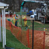 Pipeline workers probe the ground on Lisa Drive in West Whiteland Township where sinkholes have developed as a result of the Mariner East 2 construction. Vandalism to pipeline construction equipment has garnered two separate $10,000 rewards.