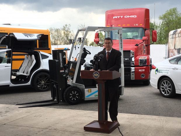 "Patrick McDonnell, secretary of the Department of Environmental Protection, announces ""Driving PA Forward,"" an initiative to use Volkswagen settlement money for cleaner vehicles and engines. He and other state and local officials, as well as business leaders, spoke Thursday surrounded by clean vehicles and machinery at an American Natural Energy Centre in Cheswick."