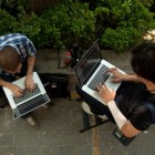journalists on laptops