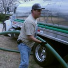 A worker from H202U delivers water to the parched town of Spicewood Beach Monday, January 30.