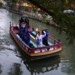 The San Antonio riverwalk uses treated waste water to keep things flowing. In this photo, torchbearer Frederico Ng carries the Olympic Flame along the Riverwalk during the 2002 Salt Lake Olympic Torch Relay in San Antonio, Texas.