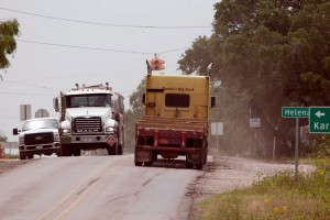 Truck traffic on FM 81 in the Eagle Ford Shale formation area.