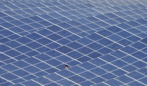 A technician works on solar panels on May 9, 2011 in Les Mees, southern France.