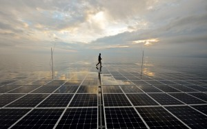 French Erwann Le Rouzic, captain of Planetsolar catamaran, the first boat around the world with solar energy, walks over the photovoltaic panel during his 581st day of sailing around the world, in the Mediterranean Sea near Corsica on May 1, 2012 .