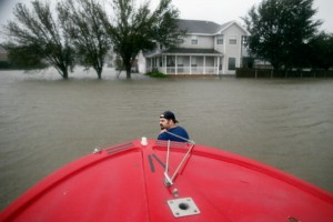 Henry Cox pulls his boat through deep water while rescuing residents from the flood waters of Hurricane Isaac in the River Forest subdivision on August 29, 2012 in LaPlace, Louisiana.
