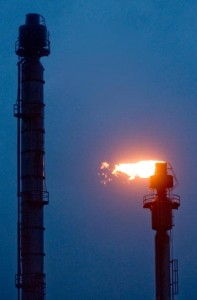 An oil refinery stack flaring.