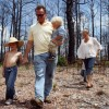 The Gwin family walks through the aftermath of the Labor Day fires.
