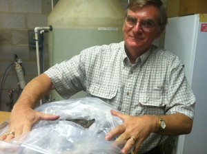 Tom Byram, with the Texas Forest Service, and a bag of Loblolly Pine seeds.