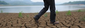 A man walks along the dried-up the banks of the Yangtze river, China's longest and most economically important river, in Wuhu, east China's Anhui province on May 27, 2011, where water levels have been 40 percent lower than average levels of the past 50 years.