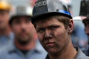 A coal miner looks on as Republican presidential candidate and former Massachusetts Governor Mitt Romney speaks during a campaign rally at American Energy Corportation on August 14, 2012 in Beallsville, Ohio.