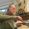 Tom Ellis has been making mandolins in Austin since the 1970s. He says the restrictions on importing and exporting tone woods have had a chilling effect on small traditional manufacturers.