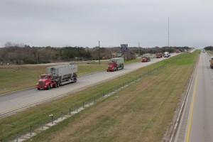 Convoy of Halliburton trucks on Interstate 10