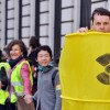 A man dressed as a nuclear waste drum stands in front of protesters holding hands on March 9, 2013 in the center of Paris. New legislation in Texas could promote the importation of more radioactive waste into Texas.