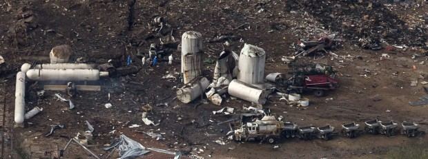 An aerial view shows investigators walking through the aftermath of a massive explosion at a fertilizer plant in the town of West, near Waco, Texas April 18, 2013.