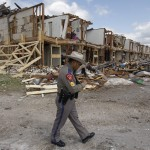 Texas Department of Public Safety Sergeant Jason Reyes walks past the site of an apartment complex destroyed by the deadly fertilizer plant explosion in West.