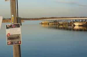 A sign in Smithville, Missouri warns boaters about zebra mussels.