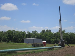 Crews bury the Crosstex NGL pipeline in a farm field in East TExas. The pipeline has been the cause of ongoing litigation.