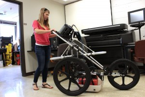 "Geology research student Kirstie Haynie at the University of Houston with ground penetrating radar ""stroller"""