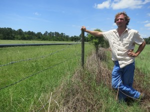 Jake White, a Jefferson Country farmer, looks at a section of the Crosstex NGL pipeline before it is buried under his field.