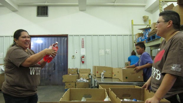 "Staff and volunteers prepare food boxes at the West Texas Food Bank in Odessa.  ""Food insecurity"" in the Permian Basin dropped from 2011 to 2012."