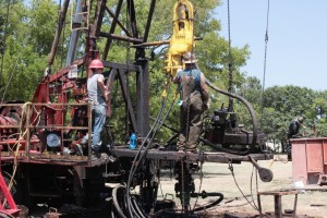 "Roughnecks on drilling rig ""working over"" an old well along a city street in Kilgore. Hear more in our RADIO STORY"