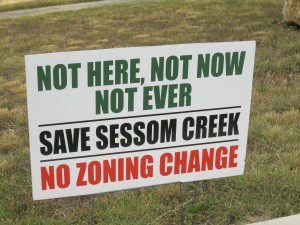 A yard sign in San Marcos' Sessom Creek neighborhood protests a local rezoning proposal. The city council turned down the proposal, and set a three-year waiting period before new zoning plans for the neighborhood can be submitted.
