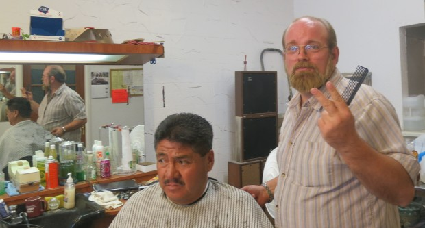 Barber Bruce Connelly with a client at The Barbershop in Odessa, Texas.