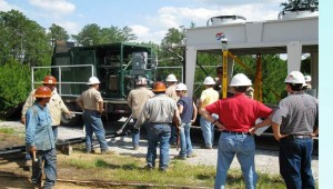 Crew installing geothermal power generator at well site near Laurel, Mississippi.