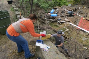 Volunteers clear debris from Onion Creek.