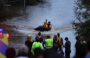 First responders pull flood victims from a flooded South East Austin neighborhood.