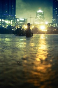 A statue of Stevie Ray Vaughn wait-deep in water, taken the night of the flood.