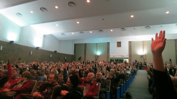 "Residents raise their hands who say they've heard a loud ""boom"" accompanying some recent earthquakes."