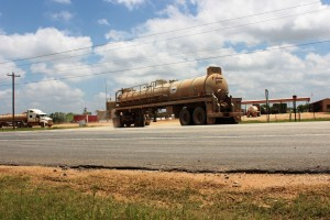 Trucks at a state-authorized disposal site in Frio County, Texas